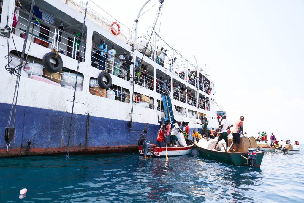 fishing boats around the MV Ilala in Lake Malawi waiting to board passengers and cargo
