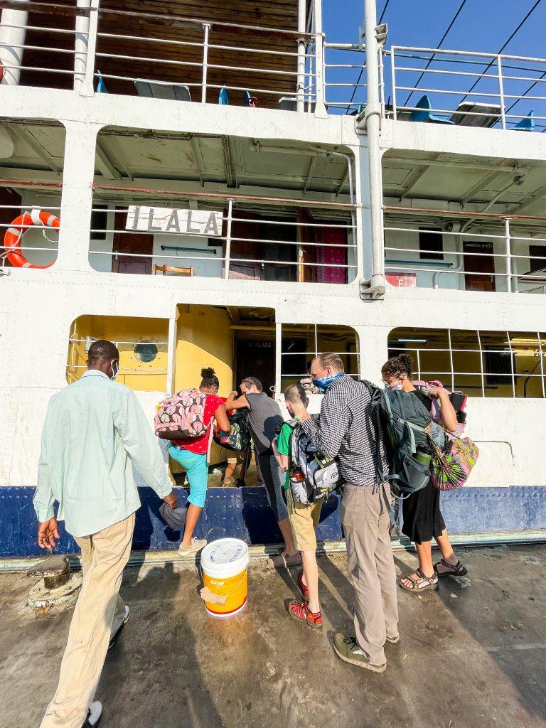 people boarding the Ilala boat in Malawi on Lake Malawi from the dock in Monkey Bay