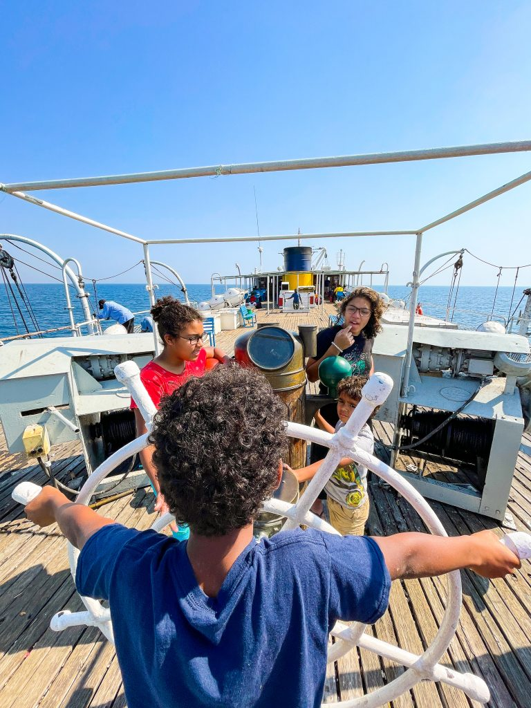 Kids playing on the top deck of the Ilala boat in Malawi on Lake Malawi