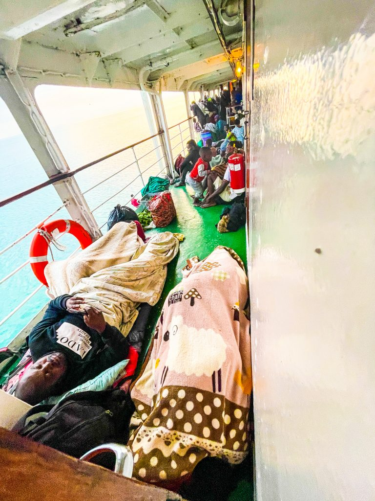 passengers aboard the Ilala boat in Malawi on Lake Malawi sleep all over the crowded deck