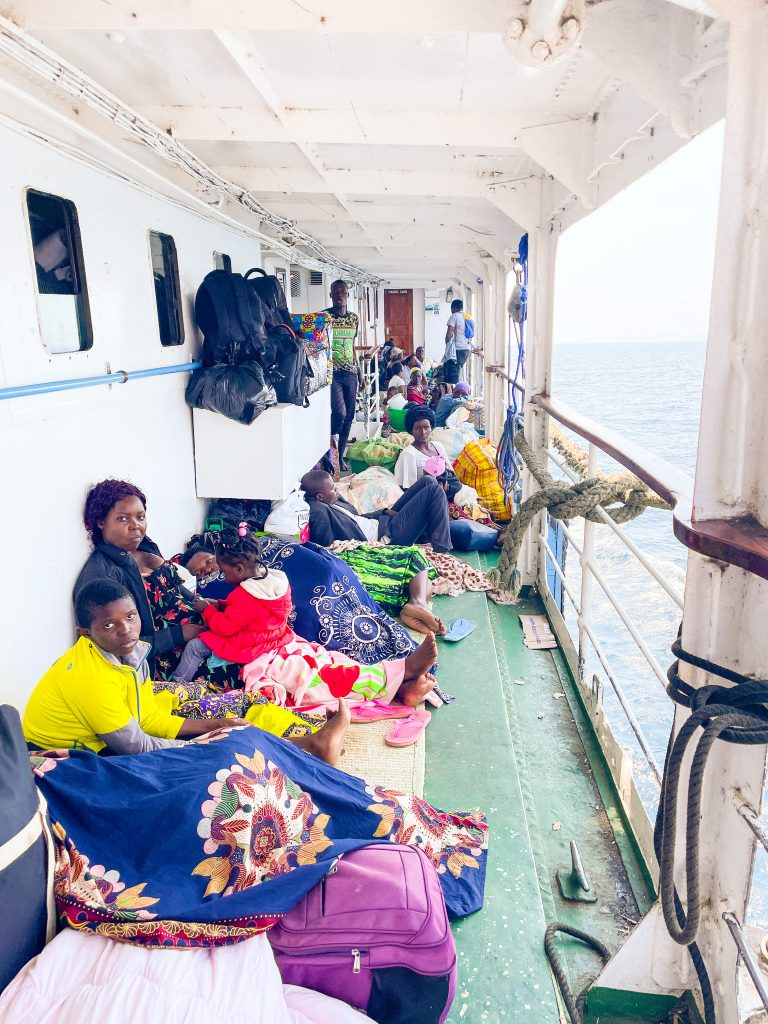 passengers aboard the Ilala boat in Malawi on Lake Malawi sleep and sit all over the crowded deck
