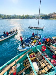 fishing boats waiting in Lake Malawi at Likoma Island to take passengers and cargo from the MV Ilala to the island