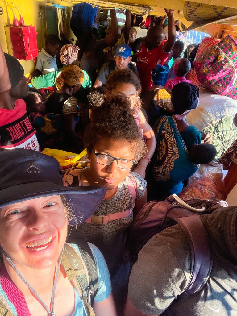 a family pushes through the crowded bottom deck of the MV Ilala in Lake Malawi to disembark at Likoma Island