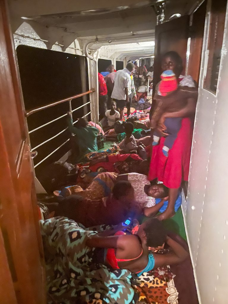 passengers aboard the Ilala boat in Malawi sleep all over the crowded deck