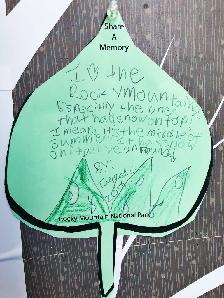a child's writing on construction paper about a memory of rocky mountain national park, it says I heart the rocky mountains, especially the ones that have snow on top! I mean, it's the middle of the summer and it has snow on it all year round!