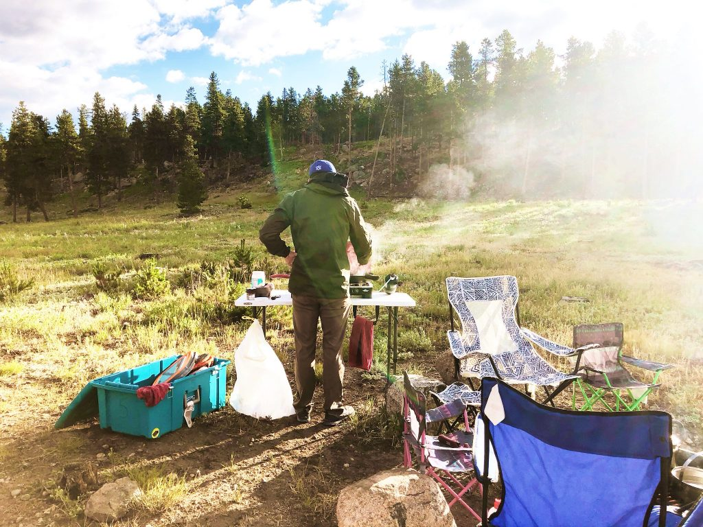 cooking breakfast at sunrise at our campsite at glacier basin campground in rocky mountain national park