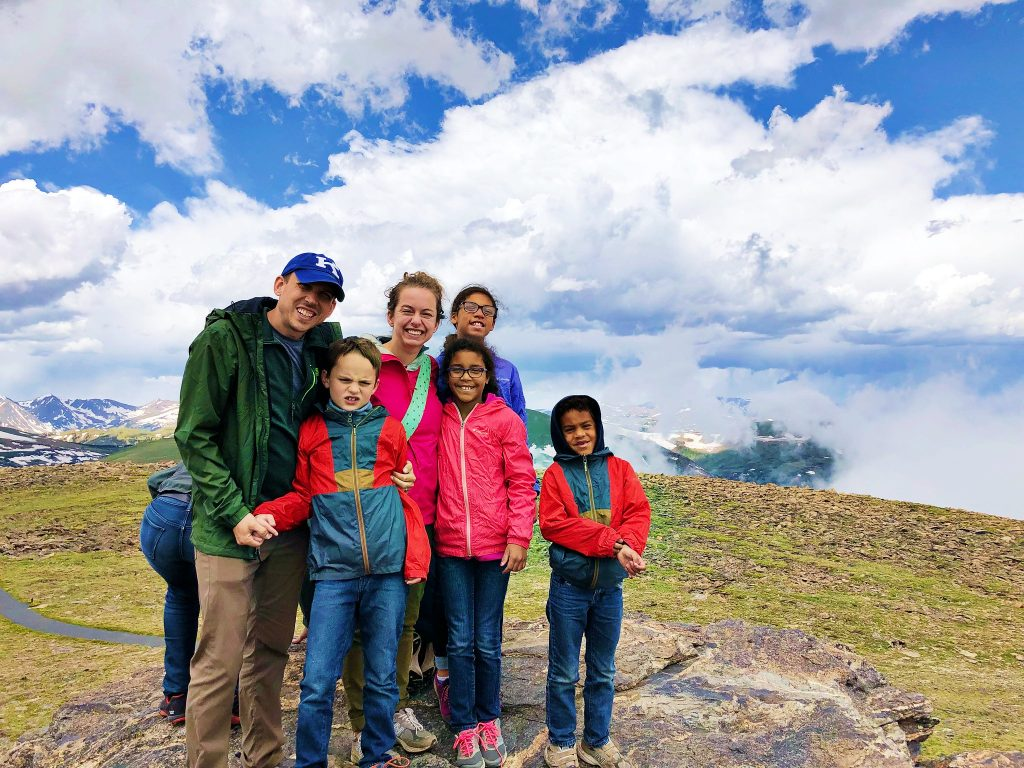 a family smiles at the end of tundra communities or toll memorial trail on trail ridge road in rocky mountain national park