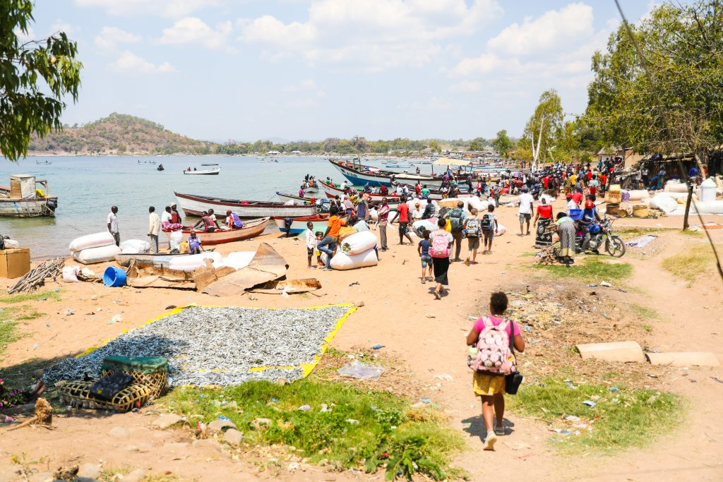 passengers and cargo wait on the shore at Likoma Island to board the MV Ilala boat in Lake Malawi.