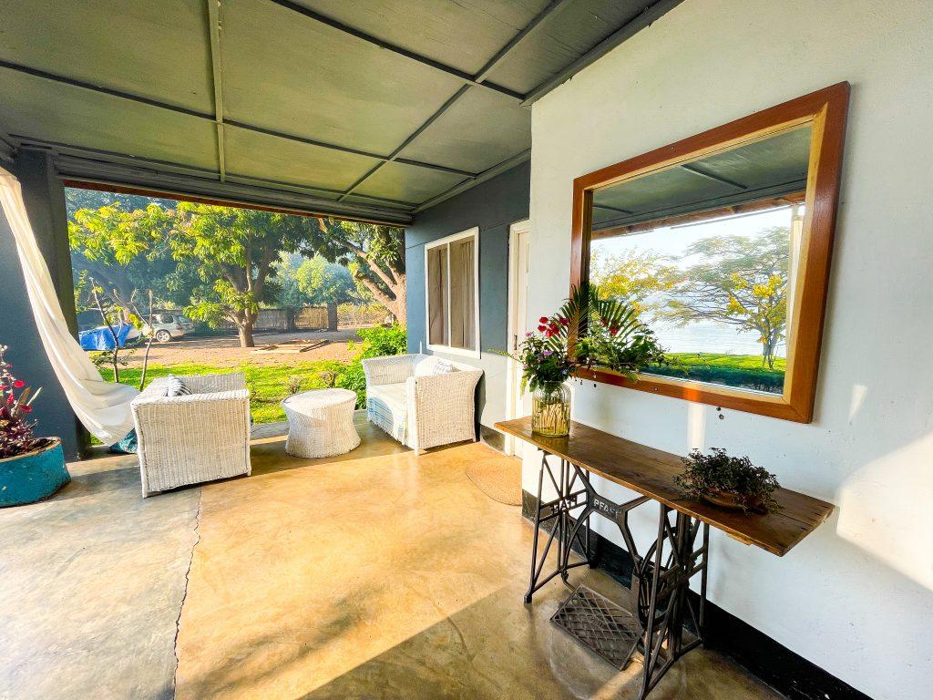 One of the khonde verandah porch seating areas at Monkey Bay Beach Lodge on Lake Malawi