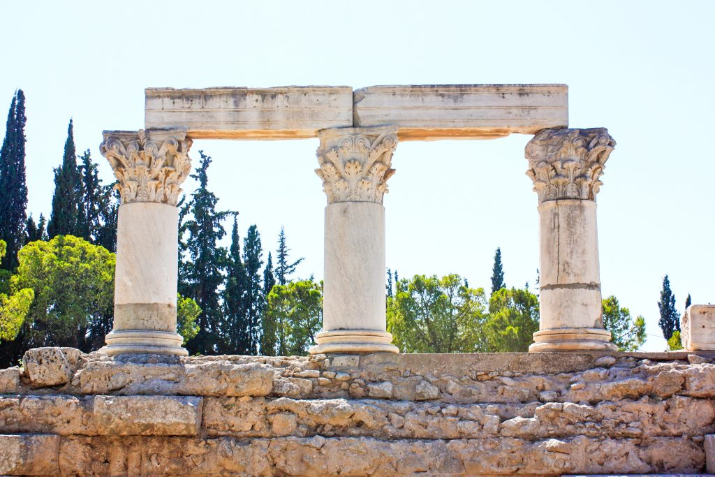 three ornate columns are all remain of the temple of octavia in corinth, greece